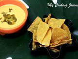 Baked Tortilla Chips with Homemade Nacho Cheese Sauce