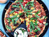 Pepper Corn Arugula Pizza with Sun-Dried Tomatoes and Mayonnaise Pepper Drizzle