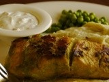 Pan grilled salmon served with hung curd dip, mashed potatoes and steamed greens