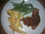Spicy Lamb Cutlets with Seasoned Wedges and Garlic Beans