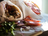 Greek Gyro in pita bread | Marinated pork loin with tzatziki sauce in Greek bread
