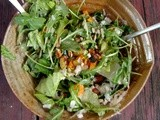 Arugula salad with roasted carrots, beets, pecans and shaved goat cheese