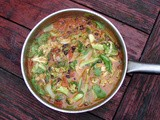 Bok choy and black beans simmered in tomato coconut sauce
