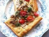 Castelvetrano pistachio and white bean pizza with a chickpea flour crust
