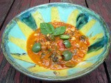 Chickpea stew with tomatoes, chard and castelvetrano olives