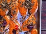 Crostini with roasted red pepper/hazelnut sauce, capers, and olives