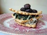 Hazelnut sage cracker fans stacked with roasted mushrooms, french lentils and chard