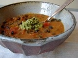 Kale and black beans in curried pumpkin sauce with pumpkinseed-arugula pesto