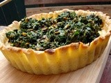 Pistachio ricotta tart topped with greens