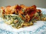 Raggedy pasta filled with spinach, ricotta, artichoke hearts topped with roasted red pepper pine nut sauce