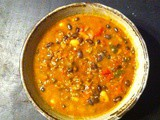 Red rice, red lentil, and black bean chili