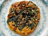 Roasted butternut-choux nests with spinach, pecans and smoked gouda