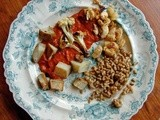 Roasted cauliflower, potatoes and butterbeans in spicy red pepper – olive sauce