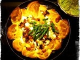 Semolina dumpling ring with roasted butternut, butter beans and spinach-almond-asparagus pesto