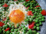 Eggs with peas and tomatoes, flavored with cumin and chili flakes
