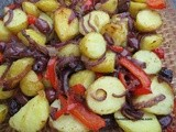 Potato, red onion, pepper and olive bake with cumin and chili flakes