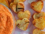 Red pepper dip with feta cheese and heart shaped potatoes