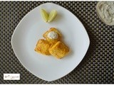 Spiced Batter Baked Fish Topped with Dill Pickle Yogurt Raita