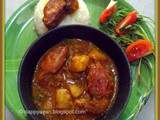 Chingri macher Dum (Prawns cooked in dum style)