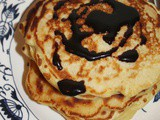 Old-fashioned oatmeal pancakes with butter-molasses sauce