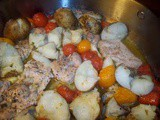Roasted chicken with baby potatoes and tomatoes