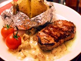 Tenderloin Steak with Mushroom Sauce and Jacket Potatoes