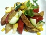 Wedges of potato and tomato with double zuchini salad