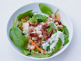 Bean and Quinoa salad complimented with spinach, topped with a lemon & garlic yogurt dressing