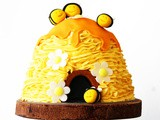 3D Beehive Cake with honey drips and buzzing bees