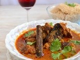 Aatu Kaal Paaya ( Smoked leg of lamb cooked in a spicy sauce )