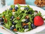 Arugula & Blueberry Salad w/ Goat Cheese, Honeyed Sunflower Seeds &  Strawberry Vinaigrette