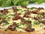 Pesto Pizza w/ Italian Sausage, Slow-Roasted Tomatoes & Spring Herb Gremolata