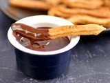 Vegan churros with chocolate sauce