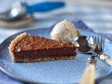 Vegan peanut butter and chocolate tart with roast banana ice cream