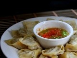 Momo – Nepali style steamed dumplings with hot tomato chili sauce