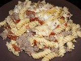 Rotini with Sausage, Artichokes, and Sun-Dried Tomatoes