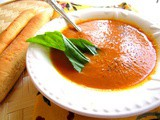 Carrot and tomato soup with fresh basil