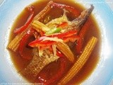 Whole Fish Cooked in Chinese Style With Pepper and Baby Corn