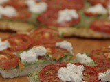 Cauliflower Pizza Crust with Pesto and Tomatoes