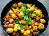 Spicy Jeera Aaloo   ( Baby potatoes tossed in  crushed cumin seeds and aromatic Indian spices )