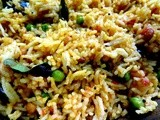 Tomato Rice with spring onions and green peas